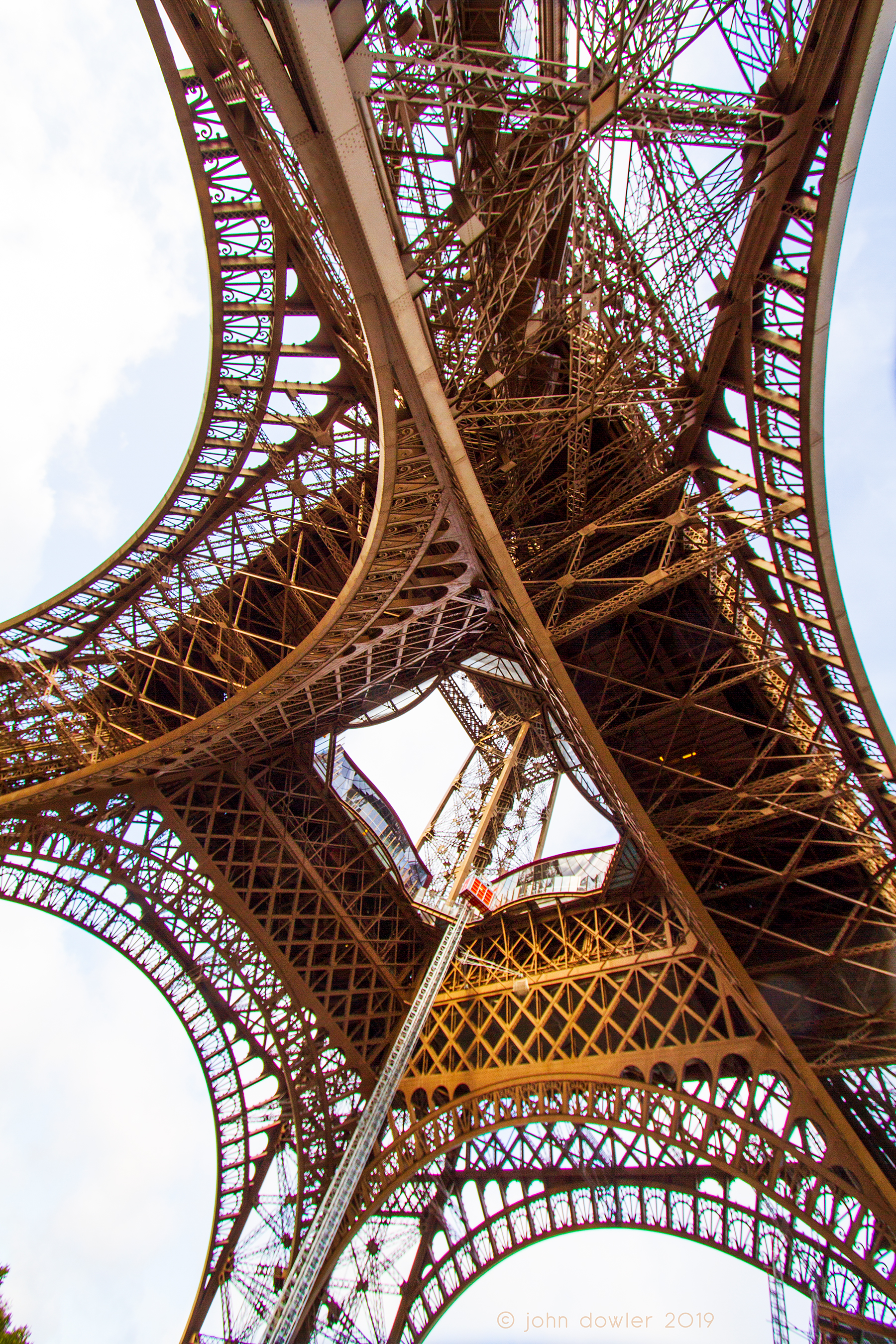 An angle on the Eiffel Tower from underneath.