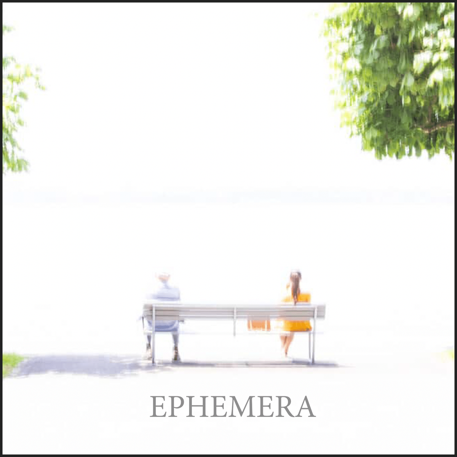 a bright soft focus image of a man and woman on a bench looking out into a white void