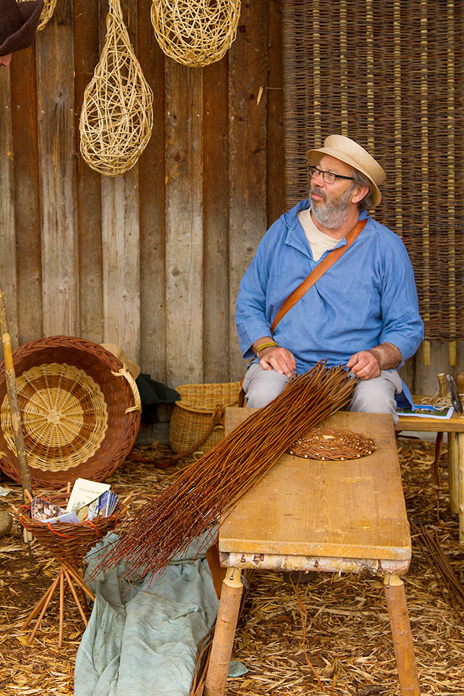 Basket weaver at medieval fair in Hutwil, Switzerland, 2016