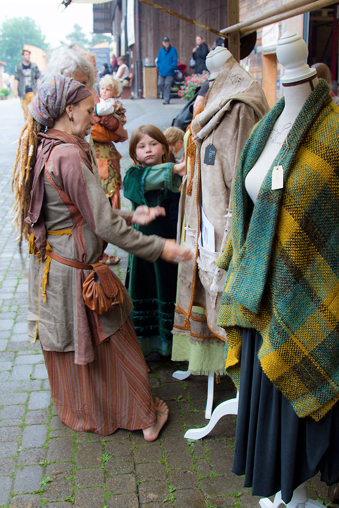 Handmade clothes Fire maker at medieval fair in Hutwil, Switzerland, 2016