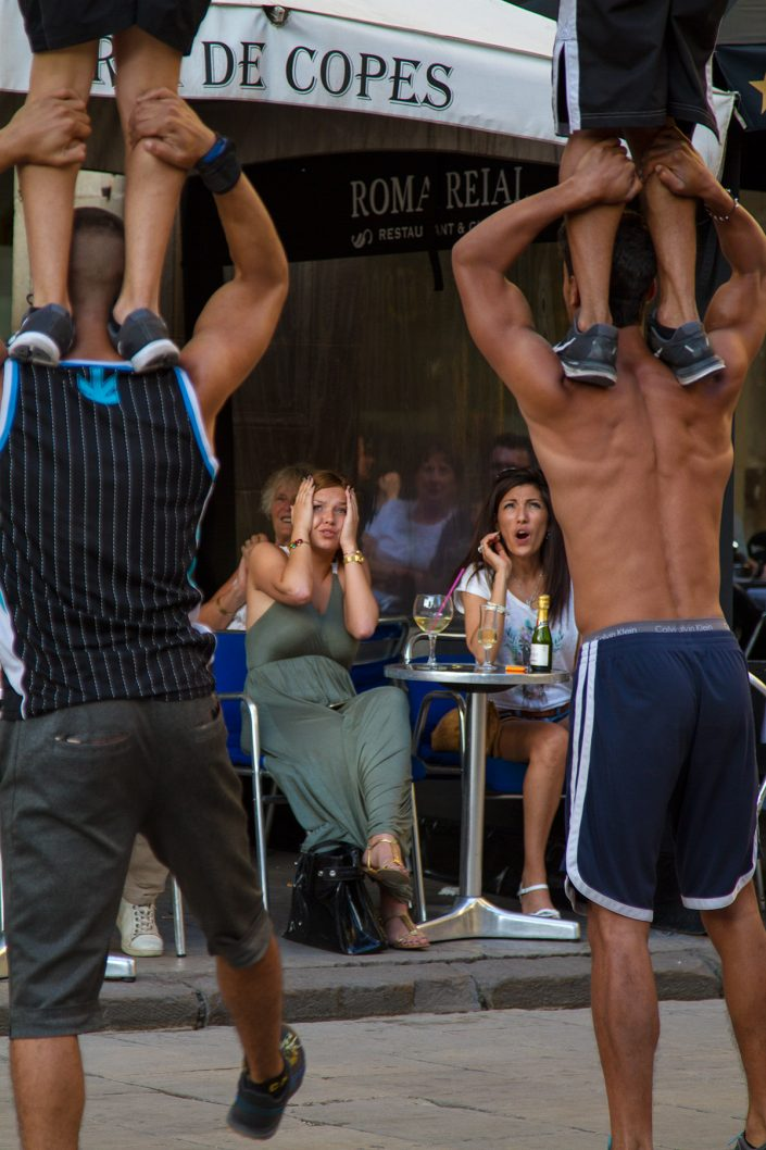 Tourists anxiously watching acrobats in Barcelona old city 2016